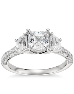 Lavishly romantic, this stunning platinum and diamond engagement ring showcases 1/2 carat total weight of perfectly matched half-moon cut diamond sidestones and three rows of scintillating micropavé set diamonds. Price listed below is for the setting only.