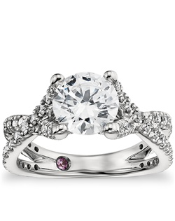 Celebrate lavishly with this platinum engagement ring, showcasing a striking cathedral design and opulent pavé-set diamonds. A signature blush pink sapphire is set in the interior of the shank. Price listed below is for the setting only.