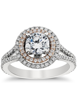 Undeniably striking, this platinum and rose gold engagement ring showcases a dramatic depth of pavé-set diamonds arranged in a double halo and split shank design that reflect pure sophistication. Price listed below is for the setting only.