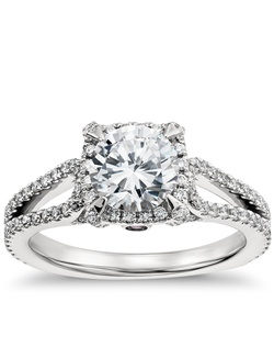 Undeniably striking, this platinum engagement ring showcases a dramatic depth of pavé-set diamonds arranged in a halo and split shank design that reflect pure sophistication. Price listed below is for the setting only.