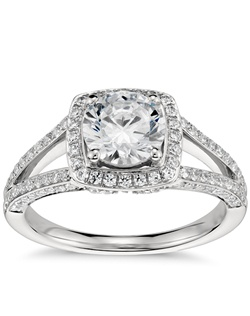 An elegant statement, this split-shank diamond halo engagement ring captures all the romance with pavé set diamond accents and two signature blush-pink sapphires set on the sides. Price listed below is for the setting only.