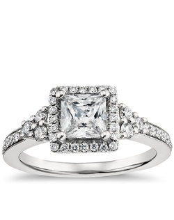 Alluring in every way, this intricate platinum engagement ring showcases a distinct halo design, a bevy of pavé-set diamonds, and a pink sapphire that accents its graceful aesthetic. Price listed below is for the setting only.