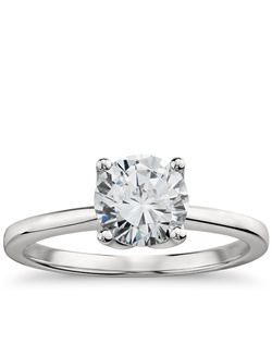 Elegant in its simplicity, this classic yet striking solitaire engagement ring features delicate petal prong detailing that will showcase your center diamond. Price listed below is for the setting only.