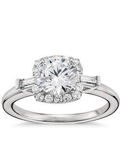 This strikingly sophisticated platinum engagement ring showcases your center diamond with a scintillating pavé-set diamond halo and two classic baguette-cut diamond accents. Price listed below is for the setting only.