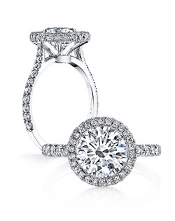 Handcrafted, custom made Jean Dousset signature design.  Available in all diamond cuts - Shown with a Round Brilliant Cut diamond center stone.  Available in platinum or 18k gold - Pictured in Platinum.  Includes your choice of damond or gem Signature Stone, exclusively by Jean Dousset.