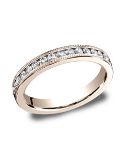 This elegant 3mm channel set eternity band features 33 round ideal-cut diamonds along the center with milgrain. Total approximate carat weight is .66ct.