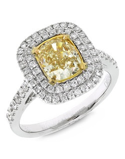 This stunning double halo ring features a natural fancy yellow diamond accented by white diamonds of G-H Color, SI1-SI2 clarity. The center diamond is certified by EGL.