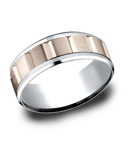 This awesome 8mm Multi-Gold comfort fit band features a beautifully carved satin finished center.