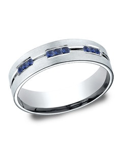 This beautiful 14 karat white gold 6mm comfort-fit etched channel set sapphire eternity band features a satin-finished and a polished horizontal center trim between rows of three round cut sapphires. Total sapphire weight is approximately .36ct.