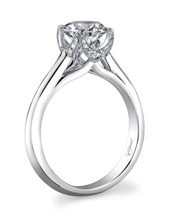 An enduring classic, this solitaire ring is adorned with pave diamonds in a crown-like setting. Standard size created for a 1CT center stone.