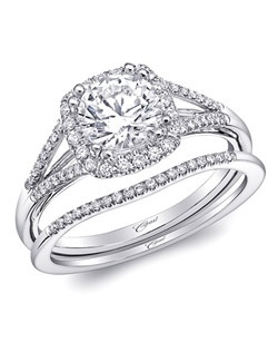 This beautifully tailored split shank halo engagement ring from the Charisma Collection is encrusted in petite diamonds. Created for a 1CT center stone. Shown with matching diamond band.