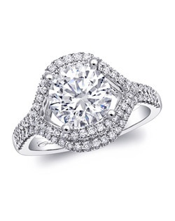 A round 2CT center stone is framed by an open marquise design, which is covered with two rows of sparkling diamonds.