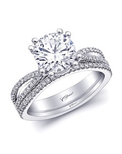 A 2CT center stone held by double prongs, and an open marquise shape on the shoulders make this ring a stunning statement. Shown with a matching diamond band which contours to fit the engagement ring.