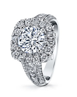 A bold, glamorous look, this Charisma platinum engagement ring features a mixture of prong and fishtail set diamonds which sparkle from every angle. Created for a 2CT round center stone.