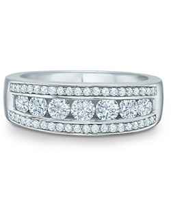 Ornate but never ostentatious, this 14K white gold band displays round diamonds in three channels, totaling 1 carat. Smaller diamonds on either side frame a row of larger stones, creating a ring for women who prefer a little extra sparkle in their lives.
