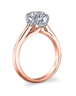 This two-tone rose and white gold ring features a crown-like setting for the center stone and a highly polished rose gold shank. Petite pave set diamonds surround the center stone, adding sparkle from every angle. Standard size created for a 1CT center stone.