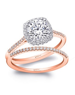 This petite engagement ring design features a 1CT center stone hugged by a cushion shaped white gold halo. A rose gold shank adds a unique design element. Shown with matching diamond band in rose gold.