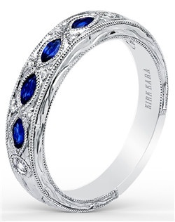 This nature-inspired design with floral details is from the Dahlia collection. It features 0.35 ctw of blue sapphires and 0.08 ctw of diamonds. The signature handcrafted details include floral hand engravings and milgrain edging. Wedding band is also available as shown featuring all diamonds (K1120D-B) or pink sapphires (K1120VD-B). Matching engagement ring is also available as shown featuring blue sapphires (K1120SDC-R), all diamonds (K1120DC-R) or pink sapphires (K1120VDC-R).