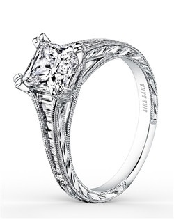 This timeless classic is a tapered engagement ring from the Stella collection. It features 0.44 ctw of diamonds. The signature handcrafted details include wheat hand engravings and milgrain edging. The center 1 carat princess stone (shown) is a customized option. Matching wedding band is also available as shown (K1151D-B).