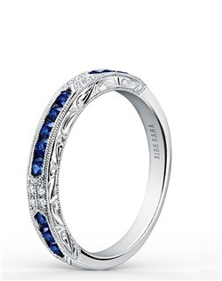 This deco inspired classic is an artistic design from the Charlotte collection. It features 0.47 ctw of blue sapphires and 0.03 ctw of diamonds. The signature handcrafted details include scroll hand engravings and milgrain edging. Wedding band is also available as shown featuring all diamonds (K1390D-B) or pink sapphires (K1390VD-B). Matching engagement ring is also available as shown featuring blue sapphires (K1390SD-R), all diamonds (K1390D-R), or pink sapphires (K1390VD-R).