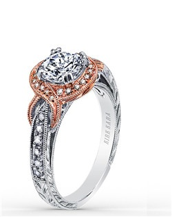 Award winning design. This elegant design is a halo engagement ring from the Pirouetta collection. It features 0.23 ctw of diamonds. The signature handcrafted details include wheat hand engravings, milgrain edging, peek-a-boo diamonds, signature filigree and rose gold accents. The center 1 carat round stone (shown) is a customized option. Engagement ring is also available as shown in all white (K150R65R) or featuring yellow gold accents (K150R65RWY). Matching wedding band is also available as shown in rose gold (K1170DP-B), all white (K1170D-B), or yellow gold (K1170DY-B).