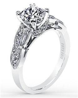 Award winning design. This nature-inspired design with floral details is from the Dahlia collection. It features 0.11 ctw of diamonds. The signature handcrafted details include milgrain edging and peek-a-boo diamonds. The center 1 carat round stone (shown) is a customized option. Matching wedding band is also available as shown (K156-B). Price varies based by gem, metal, and customization options. Visit www.kirkkara.com for prices.