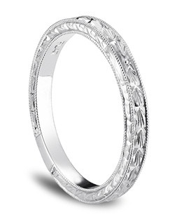 Exquisitely hand-engraved, this wedding ring features an intricate motif in enduring platinum.