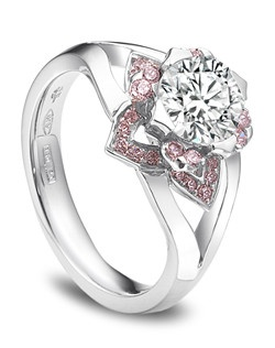 Pink platinum ring with round center diamond.