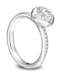 Platinum full bezel diamond ring with channel set diamond side stones.