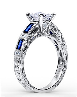 This deco inspired classic is an artistic design from the Charlotte collection. It features 0.09 ctw of diamonds and 0.75 ctw of blue sapphires. The signature handcrafted details include scroll hand engravings, milgrain edging and peek-a-boo diamonds. The center 1 carat princess stone (shown) is a customized option. Engagement ring is also available as shown featuring all diamonds (SS6685D-R), pink sapphires (SS6685P-R), green tsavorites (SS6685TS-R), or red rubies (SS6685R-R). Matching wedding band is also available as shown featuring pink sapphires (SS6685P-B1).