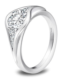 Platinum ring with round center diamond and diamond side stones.