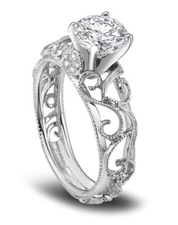 Parade Designs platinum engagement ring is vintage-inspired featuring milgrain etched scrolls curl and climb toward a show-stopping round-cut diamond.