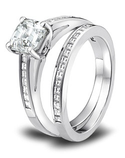 The timeless charm of channel set, carré cut diamonds. And this glamorous engagement ring's delicate design lets your center stone be the center of attention. Lines up beautifully with matching Wedding Band (R-3109/B). This Wedding Band is also available in an eternity versions. Can be custom made to fit any shape center stone.