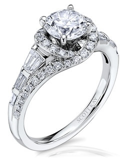 The significance of Luminaire is encrypted within its encircled galaxy of brilliance. This elegant 14K white gold Scott Kay ring has a 0.68ctw and a 1ct round center stone diamond. Also available in platinum, 18K white or yellow gold, 14K yellow gold, and palladium.  Like us on Facebook: https://www.facebook.com/scottkayusa       Follow us on Twitter: @scottkay