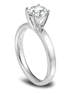 Phyllis Bergman platinum and diamond engagement ring with milgrain edges.