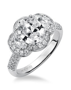 Trisha, Contemporary Three stone oval cut diamond engagement ring with diamond enhanced halo and band. Available in Platinum, 18K and 14K gold. Price listed below is for the setting only. Settings can be custom made to fit any size or shape center stone.