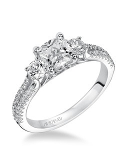 Colette, Contemporary Classic Three stone engagement ring with cushion cut center stone and round diamonds. Available in Platinum, 18K and 14K gold. Price listed below is for the setting only. Settings can be custom made to fit any size or shape center stone. Matching band available - Style number  31-V426W-L