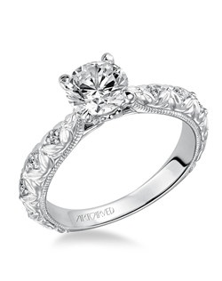 Collete, Diamond engagement ring enhanced with a beautiful satin finish engraved design on the shank, also featuring prong set stones. Available in Platinum, 18K and 14K gold. Price listed below is for the setting only. Settings can be custom made to fit any size or shape center stone. Matching band available - Style number V486W-L