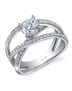 This dazzling white gold diamond engagement ring features a 1 carat round diamond center with a total of 0.40 carats in a crisscross triple diamond shank.