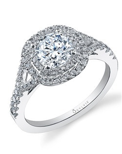 This divine white gold diamond engagement ring features a 1 carat round diamond center with a total of 0.46 carats in our signature double cushion halo and delicate split shank.