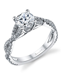 This extravagent white gold diamond engagement ring features a 1 carat round diamond center with a total of 0.38 carats in our delicate twist shank.