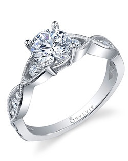This vintage white gold diamond engagement ring features a 1 carat round diamond center with a total of 0.32 carats in our timeless twist shank.