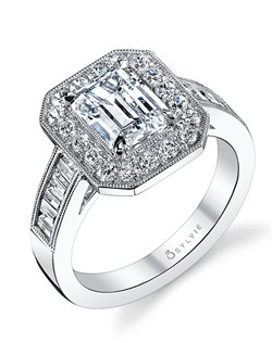 This exquisite white gold diamond engagement ring features a 2 carat emerald diamond center with a total of 0.89 carats in signature emerald-cut halo and baguette accented shank.