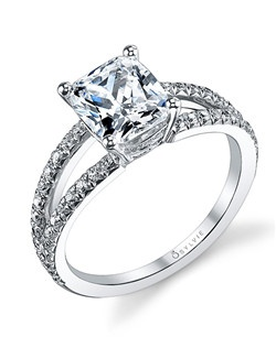 This charming white gold diamond engagement ring features a 2 carat cushion diamond center with a total of 0.39 carats in our elegant split shank.