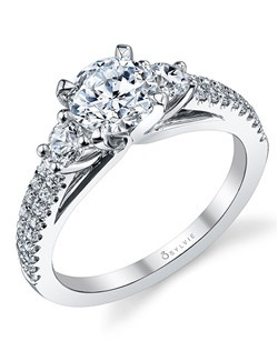 This elegant white gold diamond engagement ring features a 1 carat round diamond center with a total of 0.56 carats in our round accenting side diamonds and parallel double shank.