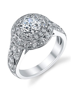 This vintage white gold engagement ring features a 1 carat round diamond center with a total of 0.90 carats in our signatures round double halo with filigree detailed shank.