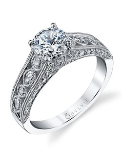 This vintage white gold engagement ring features a 1 carat round diamond center with a total of 0.64 carats in our whimsical detailed shank.