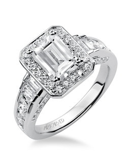 Simone, Contemporary Emerald cut engagement ring featuring a diamond halo and channel set diamond band. Available in Platinum, 18K and 14K gold. Price listed below is for the setting only. Settings can be custom made to fit any size or shape center stone.