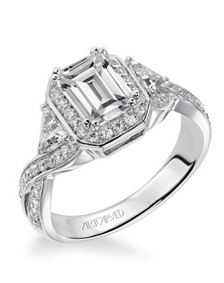 Nadine, Contemporary Emerald cut diamond engagement ring featuring a halo accentuated by trillion side diamonds and a split shank diamond band. Available in Platinum, 18K and 14K gold. Price listed below is for the setting only. Settings can be custom made to fit any size or shape center stone.