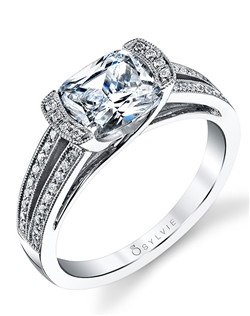 This unique white gold diamond engagement ring features a 2 carat cushion diamond center tension set with a total of 0.23 carats enhancing the unique setting and split shank.